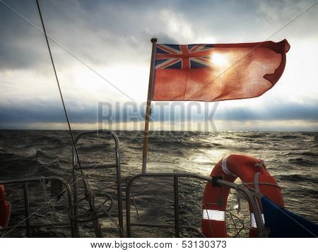Sailship with british flag on sea