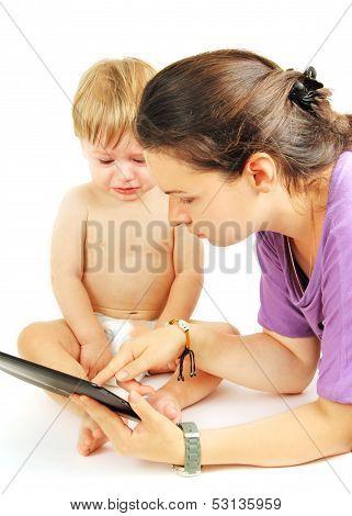 Little Kid On The Tablet.