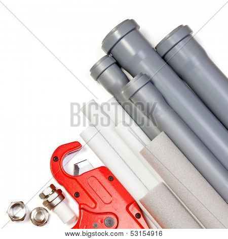Plumbing tool pipes and fittings on white background