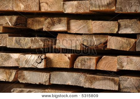 old wood boards stacked up (end view) poster