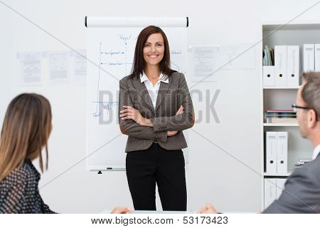 Confident Businesswoman Giving A Presentation