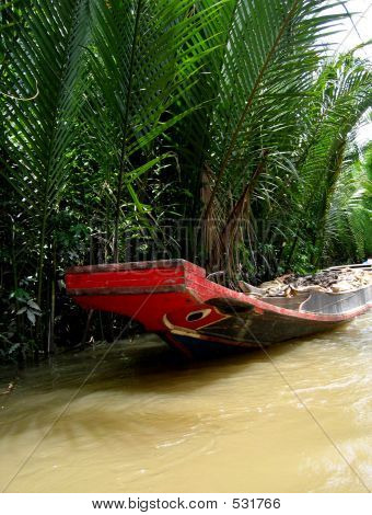 Small Boat On The Mekong River