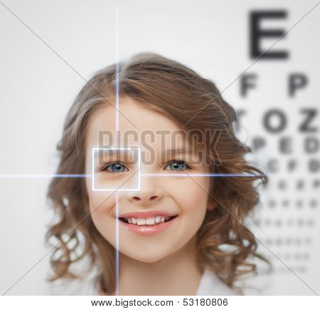 health, vision, medicine, laser correction, happy people concept - smiling pre-teen girl with optometric table or eyesight testing board