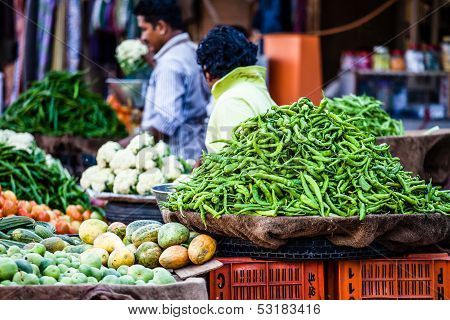 Various Different Vegetables And Mango In Wooden Baskets At The Market, Kumly, Kerala, India