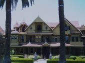 Winchester Mystery House in San JoseCA built by Sarah Winchester. poster