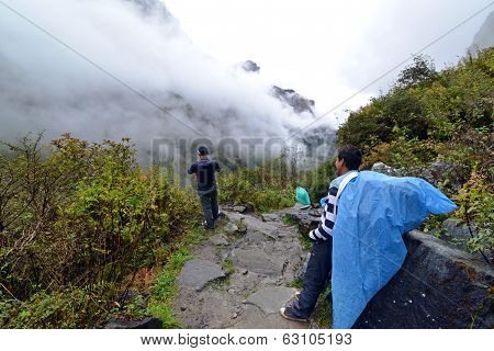 Sherpas Carrying Heavy Bags In The Himalayas