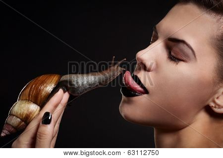 Woman With Snail Stuck Out Her Tongue. Fashion. Gothic