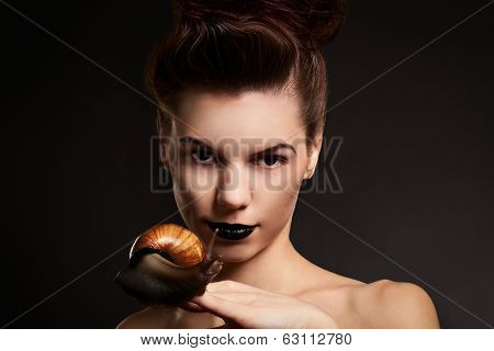 Portrait Of A Woman With Snail. Fashion. Gothic