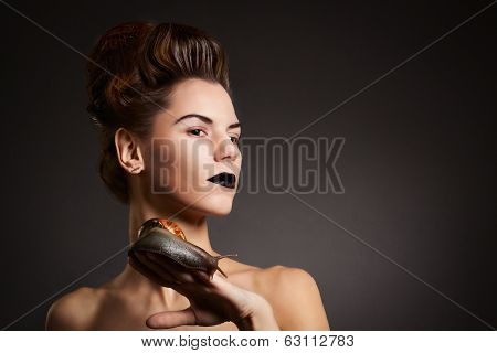 Brunette Woman With Snail With Black Eyes And Lips