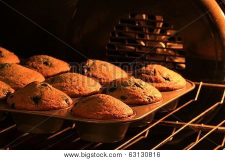freshly baked muffins in stove