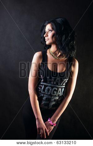 Brunette In Black Shirt Tenderly Looks Away