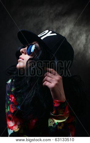 Pretty Sexy Brunette In A Black Cap And Glasses. Swag Girl. Fashion