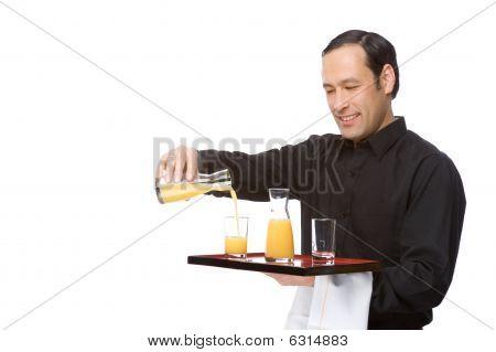 Waiter Pouring Juice