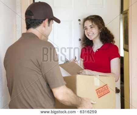 Young Woman Signs For Delivery