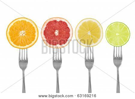 Citrus Fruit On Forks Lime, Orange, Grapefruit, Lemon