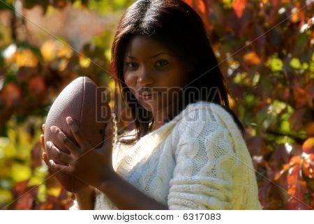 African-american Woman plays football