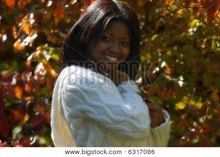 African-american Woman smiles with leaf