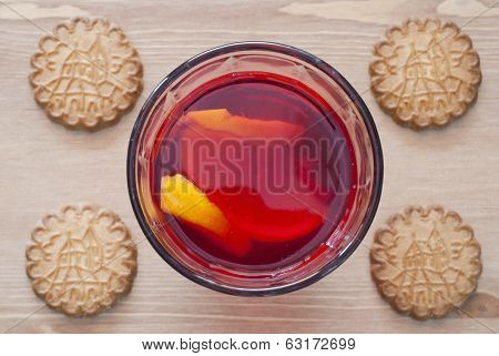 Glass with lemonade and cookies on a wooden background - view from above. poster