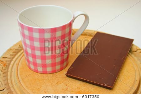 Mug and chocolate.