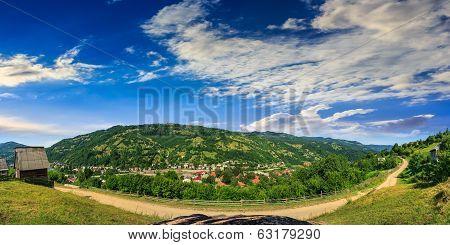 Village On Hillside Of Mountain