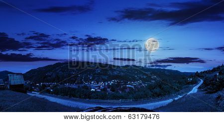 Village On Hillside Of Mountain At Night