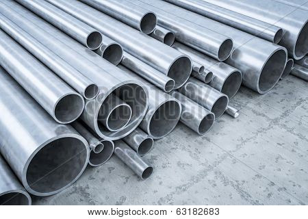 An image of some steel pipes in a warehouse