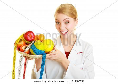 Woman in white lab coat holding fruits and colorful measure tapes isolated. Doctor dietitian recommending healthy food. Diet. poster