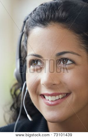 Young businesswoman using a headset