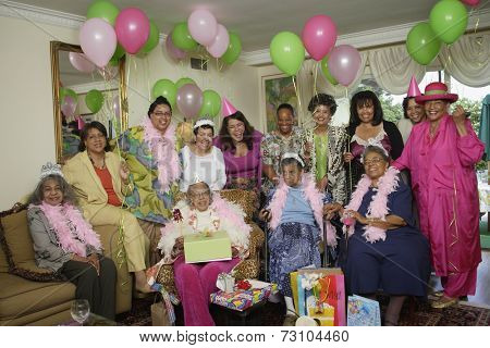 Group portrait of senior adult birthday party with balloons