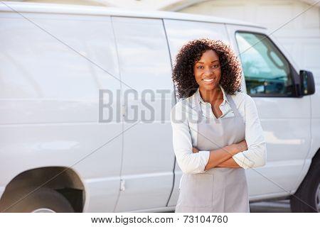 Woman Wearing Apron Standing In Front Of Van