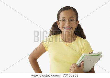 Student posing for the camera with books