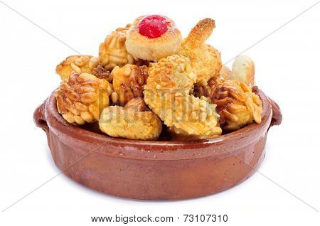 an earthenware bowl with panellets, typical pastries of Catalonia, Spain, eaten in All Saints Day, on a white background poster