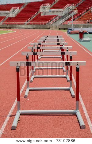 Hurdles On The Red Running Track