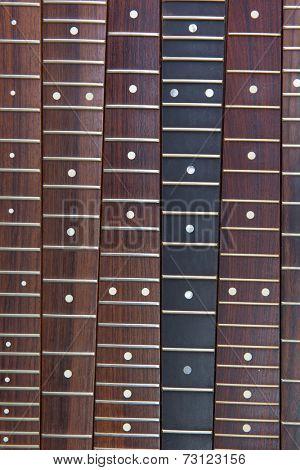 Guitar necks aligned, Rosewood, and ebony fingerboard necks