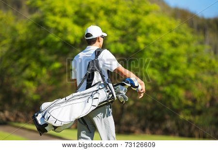 Golfer with Golf Bag Walking down the Course