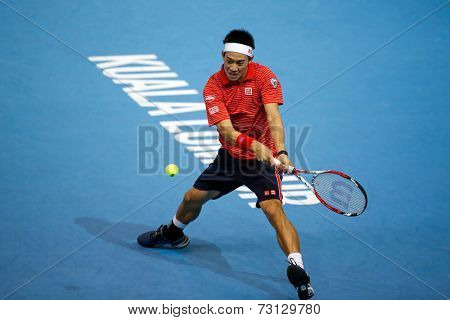 SEPTEMBER 26, 2014 - KUALA LUMPUR, MALAYSIA: Kei Nishikori of Japan prepares to hit a backhand return in his match at the Malaysian Open Tennis 2014. This event is an ATP sanctioned tournament.