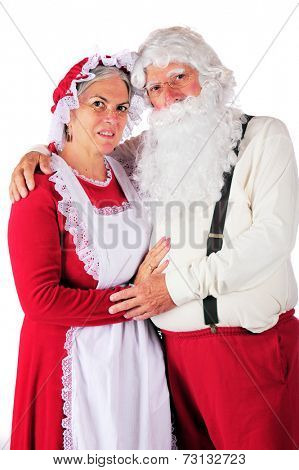Three-quarter length portrait of Mr. and Mrs. Santa in their at-home attire.  On a white background.