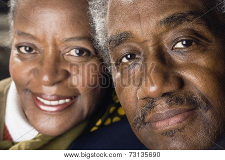 Close up of senior African couple smiling