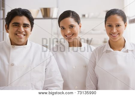 Group of bakers in kitchen