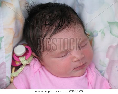 Newborn baby with pacifier