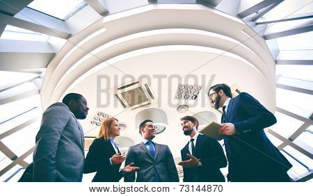 Group of competitive business people discussing ideas or plans