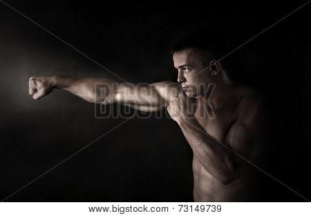 Boxer fighter on black background