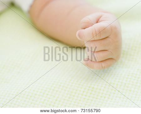 Close up of newborn baby's hand