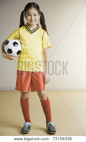 Portrait of Asian girl wearing soccer outfit