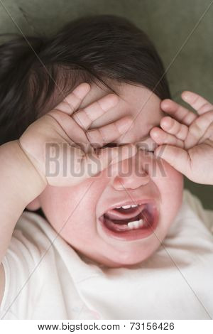 Close up of Hispanic baby crying