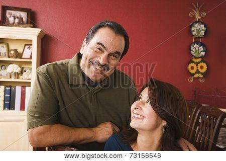 Portrait of middle-aged Hispanic couple