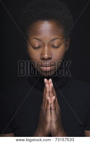 Close up of African woman praying