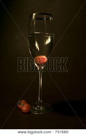 Tomato Inside The Glass In Black Background