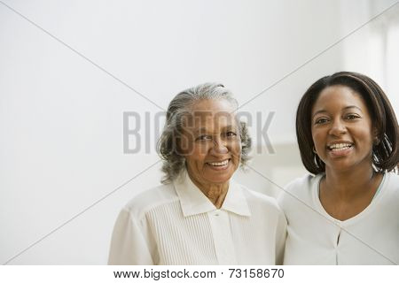 African mother and adult daughter