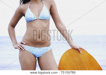 Young woman leaning on boogie board